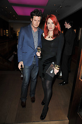 PERCY PARKER and AMY MOLYNEAUX at a cocktail party and auction to launch the forthcoming celebrations for Mikhail Gorbachev's 80th birthday held at Christie's, 8 King Street, London on 3rd February 2011.