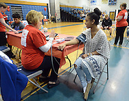 Madison Martinez (right), 15 has her blood pressure checked by Lorin Manni (left), R.N. during the Deborah Heart and Lung's screenings for possible conditions leading to sudden cardiac arrest Saturday April 30, 2016 at Northern Burlington High School in Mansfield Township, New Jersey.  (Photo by William Thomas Cain)