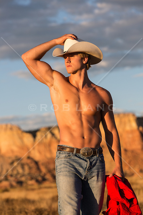 shirtless cowboy outdoors at sunset