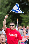 "A conservative Christian waves an Israel flag during the ""Stand With God"" rally  August 29, 2015 in Columbia, SC. Thousands of conservative christians gathered at the State House to rally against gay marriage and listen to GOP presidential candidates Gov. Rick Perry and Sen. Ted Cruz speak."