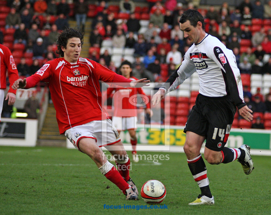 Barnsley - Saturday 21st February 2009 : Matthew Spring of Charlton Athletic & Andranik Teymourian of Barnsley in action during the Coca Cola Championship match at Oakwell, Barnsley. (Pic by Steven Price/Focus Images)