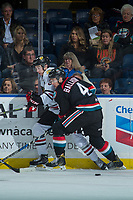 KELOWNA, CANADA - OCTOBER 20: Gordie Ballhorn #4 of the Kelowna Rockets checks Cody Glass #8 of the Portland Winterhawks into the boards during first period on October 20, 2017 at Prospera Place in Kelowna, British Columbia, Canada.  (Photo by Marissa Baecker/Shoot the Breeze)  *** Local Caption ***