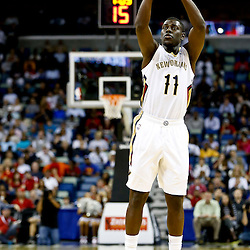 Oct 23, 2013; New Orleans, LA, USA; New Orleans Pelicans point guard Jrue Holiday (11) shoots against the Miami Heat during the first quarter of a preseason game at New Orleans Arena. Mandatory Credit: Derick E. Hingle-USA TODAY Sports