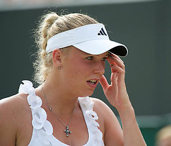 LONDON, ENGLAND - Monday, June 27, 2011: Caroline Wozniacki (DEN) looks dejected as she is defeated during the Ladies' Singles 4th Round match on day seven of the Wimbledon Lawn Tennis Championships at the All England Lawn Tennis and Croquet Club. (Pic by David Rawcliffe/Propaganda)