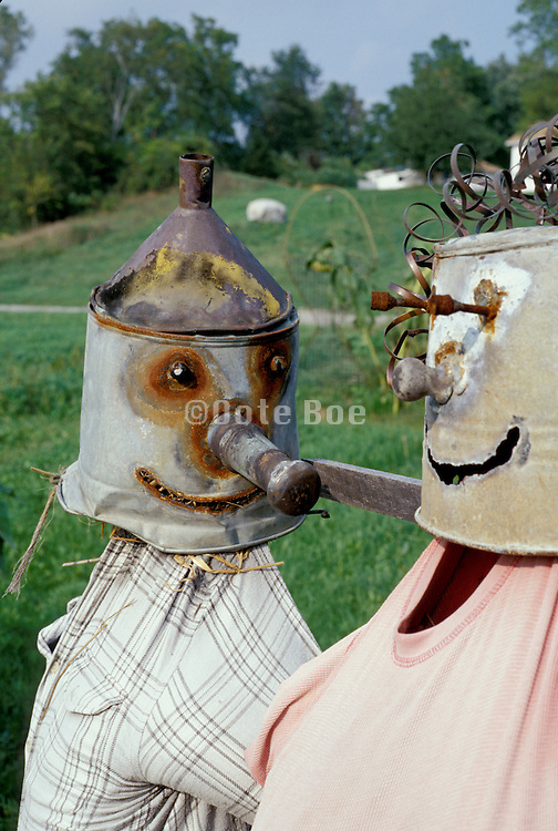 tin watering can scarecrows