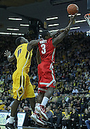 January 07, 2011: Iowa Hawkeyes center Gabriel Olaseni (0) fouls Ohio State Buckeyes guard Shannon Scott (3) as he puts up a shot during the the NCAA basketball game between the Ohio State Buckeyes and the Iowa Hawkeyes at Carver-Hawkeye Arena in Iowa City, Iowa on Saturday, January 7, 2012.