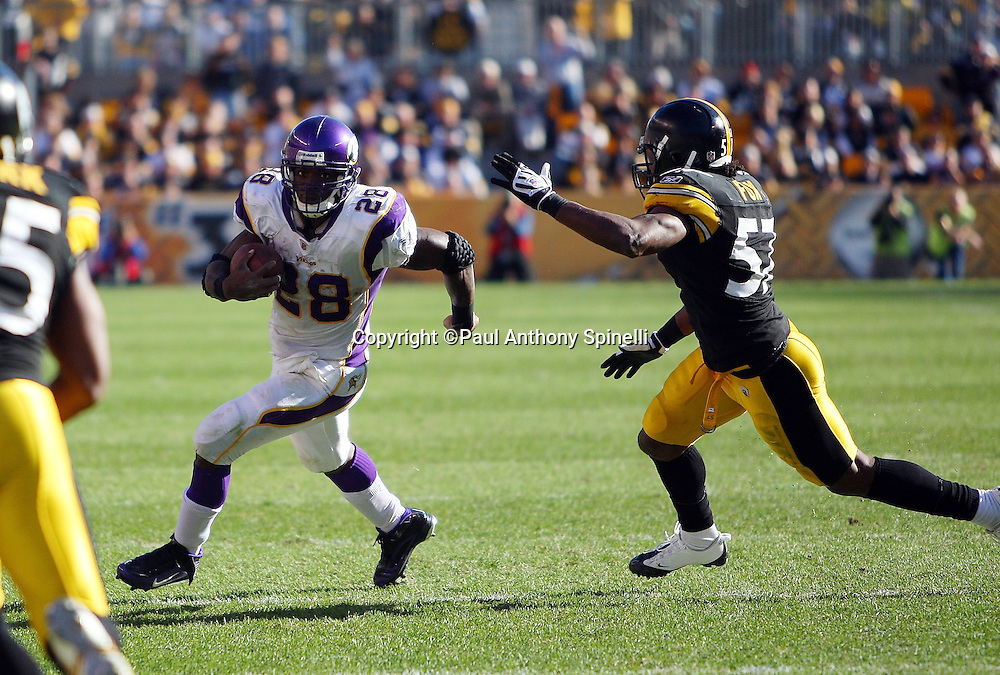 Minnesota Vikings running back Adrian Peterson (28) runs for a first down while being chased by Pittsburgh Steelers linebacker Keyaron Fox (57) during the NFL football game against the Pittsburgh Steelers, October 25, 2009 in Pittsburgh, Pennsylvania. The Steelers won the game 27-17. (©Paul Anthony Spinelli)