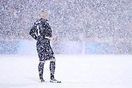 March 22nd, 2013 Commerce City, CO - U.S. National Soccer goalkeeper Brad Guzan (1) tries to keep track of the ball on the other end of the field through the snow during the second half of the World Cup qualifying match between Costa Rica and the USA Men's National Team at Dick's Sporting Goods Park in Commerce City, CO