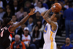 Feb 15, 2012; Oakland, CA, USA; Golden State Warriors shooting guard Monta Ellis (8) shoots over Portland Trail Blazers small forward Gerald Wallace (3) during the second quarter at Oracle Arena. Mandatory Credit: Jason O. Watson-US PRESSWIRE