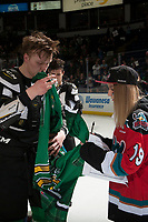 KELOWNA, CANADA - MARCH 18: Ted Brennan #10 of the Kelowna Rockets hands his jersey off his back to a fan  on March 1, 2018 at Prospera Place in Kelowna, British Columbia, Canada.  (Photo by Marissa Baecker/Shoot the Breeze)  *** Local Caption ***