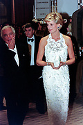 Diana, Princess of Wales walks with fashion designer Ralph Lauren, left, during a charity gala fundraising event for the Nina Hyde Center for Breast Cancer Research September 24, 1996 in Washington, DC.