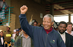 NELSON ROLIHLAHLA MANDELA (July 18, 1918 - December 5, 2013), 95, world renown civil rights activist and world leader. Mandela emerged from prison to become the first black President of South Africa in 1994. As a symbol of peacemaking, he won the 1993 Nobel Peace Prize. Joined his countries anti-apartheid movement in his 20s and then the ANC (African National Congress) in 1942. For next 20 years, he directed a campaign of peaceful, non-violent defiance against the South African government and its racist policies and for his efforts was incarcerated for 27 years. Remained strong and faithful to his cause, thru out his life, of a world of peace. Transforming the world, to make it a better place. PICTURED: 1994 - South Africa - NELSON MANDELA at a rally. (Credit Image: © Greg Marinovich/ZUMA Wire/ZUMAPRESS.com)