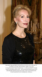 Society figure MRS DONATELLA FLICK at a dinner in London on 5th December 2000.	OJY 35