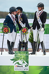 Podium Individual Grade III 1. Hannelore Brenner and Women of the World, 2. Sanne Voets and Vedet PB N.O.P., 3. Susanne Jensby Sunesen and Thy's Que Faire - Team Competition Grade III Para Dressage - Alltech FEI World Equestrian Games™ 2014 - Normandy, France.<br /> © Hippo Foto Team - Jon Stroud <br /> 25/06/14