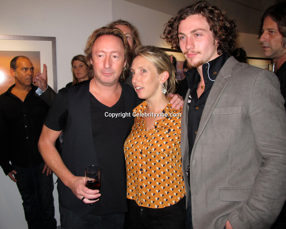 "Julian Lennon, Director Sam Taylor-Wood and Actor Aaron Johnson..""Timeless"" by Julian Lennon, Photography Exhibit Opening of John Lennon and Bono's Photographs..Morrison Hotel Gallery..New York, NY, USA..Thursday, September 16, 2010..Photo By iSnaper.com/ CelebrityVibe.com..To license this image please call (212) 410 5354; or Email: CelebrityVibe@gmail.com ; .website: www.CelebrityVibe.com."