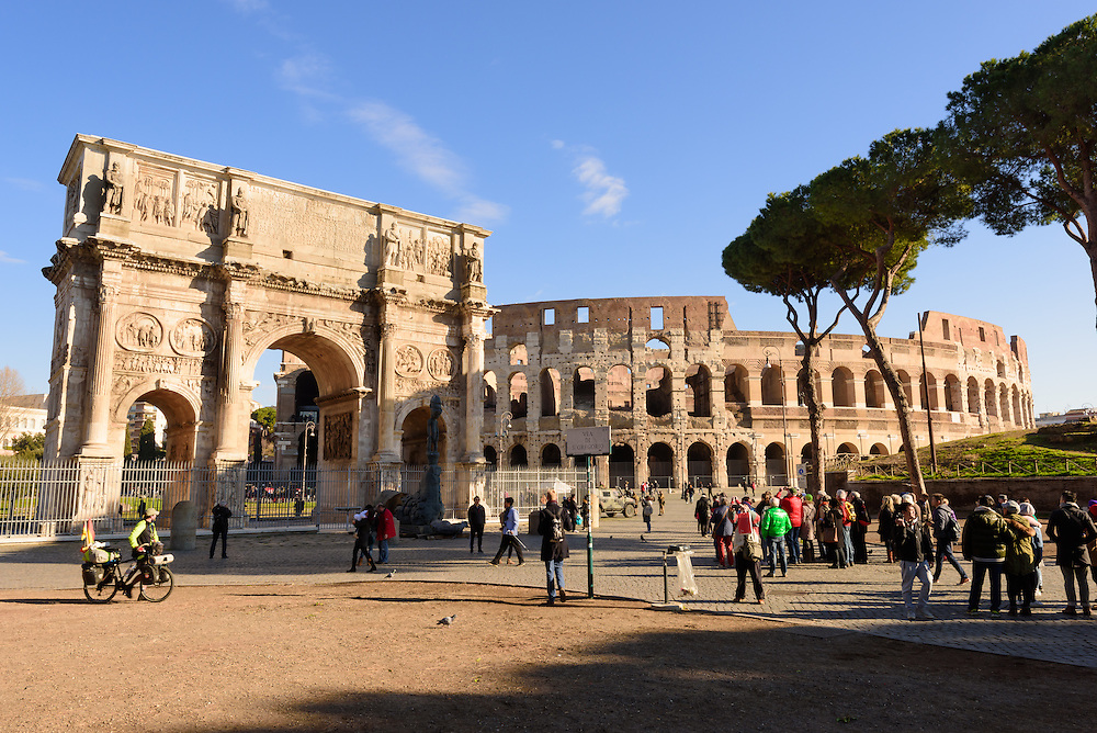 The Arch of Constantine seen next to the Colosseum and situated between the Colosseum and the Palatine Hill. The arch is located at the end of the Via Triumphalis