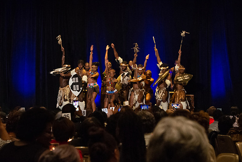 A group of Step Afrika! dancers in traditional clothing perform at the Annual Jazz Brunch.
