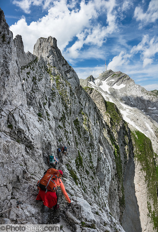 Weaving through limestone outcroppings, we hiked the stunning Lisengrat, a sinuous chain-protected trail from Rotsteinpass to the summit of Säntis. The Lisengrat is a magnificent ridge route between Säntis (2502 m / 8218 feet elevation) and Altmann (2435 m / 7989 ft), the two highest peaks in Appenzell's Alpstein range. The rocky route is safe, but can be scary for those with fear of heights. Shared by three cantons, Säntis can be reached easily via cable car or with effort via trails, to see vast mountain views across six countries: Switzerland, Germany, Austria, Liechtenstein, France and Italy. The Appenzell Alps rise between Lake Walen and Lake Constance. This image was stitched from multiple overlapping photos. For licensing options, please inquire.