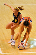 Jessica Moulds of the Tactix grabs the ball from Samantha Sinclair of the Magic during the ANZ Championship match, Tactix v Magic, 31 May 2015. Copyright Photo: John Davidson / www.Photosport.co.nz