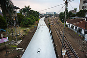 A passenger train arrives at Bandung trainstation on Java. The Kereta Api is the Indonesian name for the National Indonesian Railway company. The railway covers Java from West to East Java with a total length of more than 5.000 km of track. The Kereta Api is a state owned company dating back from the Dutch colonial periode.<br /> <br /> All trains are identified by names such as mountains or mythological symbolism.