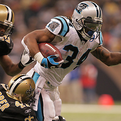 2008 December, 28: Carolina Panthers running back DeAngelo Williams (34) runs as New Orleans Saints safety Roman Harper (41) pursues during a 33-31 week 17 loss by the New Orleans Saints to NFC South divisional rivals the Carolina Panthers at the Louisiana Superdome in New Orleans, LA.