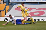 Bury Defender, Peter Clarke tackles Millwall On Loan Midfielder, Chris Taylor during the Sky Bet League 1 match between Bury and Millwall at the JD Stadium, Bury, England on 23 April 2016. Photo by Mark Pollitt.