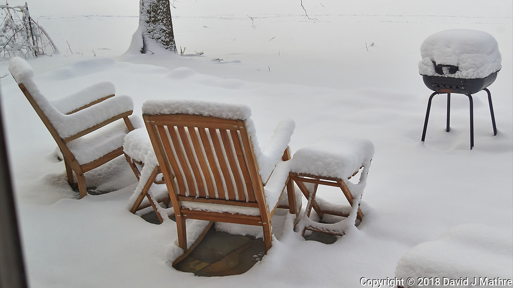 Snow covered patio chairs and grill. Image taken with a Leica TL-1 camera and 35mm f/1.4 lens (ISO 200, 35 mm, f/4, 1/800 sec).