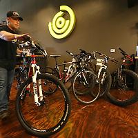 Adam Robison | BUY AT PHOTOS.DJOURNAL.COM<br /> Kurt Jones, bike mechanic at Core Outdoor, pushes a bike into his work station for a repair.