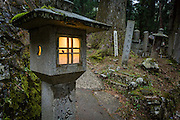 As the evening falls, the stone lanterns in Okunoin begin to light up to illumiate the path through the forest cemetery.