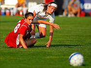 29 MAY 2010 -- FENTON, Mo. -- Incarnate Word Academy's Megan Herrington (16, red) and Cor Jesu Academy's Jenny Antonacci (16, white) get up and pursue the ball after colliding in the second half during the MSHSAA Class 3 girls' soccer quarterfinal at the A-B Center in Fenton, Mo. Saturday, May 29, 2010. CJA won, 1-0, in overtime. Photo © copyright 2010 by Sid Hastings.