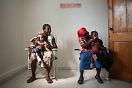 CLIENT: UNICEF<br /> <br /> Women wait with their children to be seen at an obstetrics clinic run by Haitian NGO FONDEPH in Port-au-Prince, Haiti, during a visit by a UNICEF delegation.
