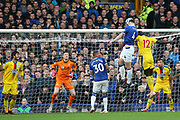 Everton defender Michael Keane (4) beats Crystal Palace defender Mamadou Sakho (12) to get the header on goal during the Premier League match between Everton and Crystal Palace at Goodison Park, Liverpool, England on 21 October 2018.