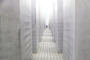 A visitor tours The Memorial to the Murdered Jews of Europe in Berlin, Saturday, Nov. 17, 2012.