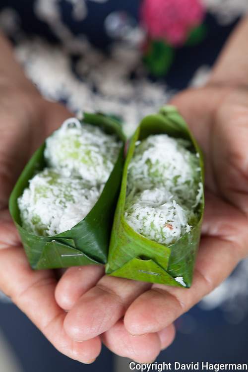 Ondeh ondeh, rice flour balls filled with palm sugar and roalled in grated coconut