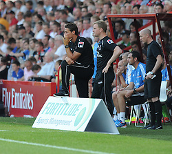 Bournemouth's manger Eddie howe watches on as the game plays. - Photo mandatory by-line: Alex James/JMP  - Tel: Mobile:07966 386802 20/07/2013 -Bournemouth vs Real Madrid  - SPORT - FOOTBALL -  Dean Court-Bournemouth - Real Madrid -