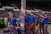 The stage crew prepares a tree for the springboard competition during the Stihl Timbersports Championships at The Norfolk Scope in Norfolk, Virginia on June 20, 2014.
