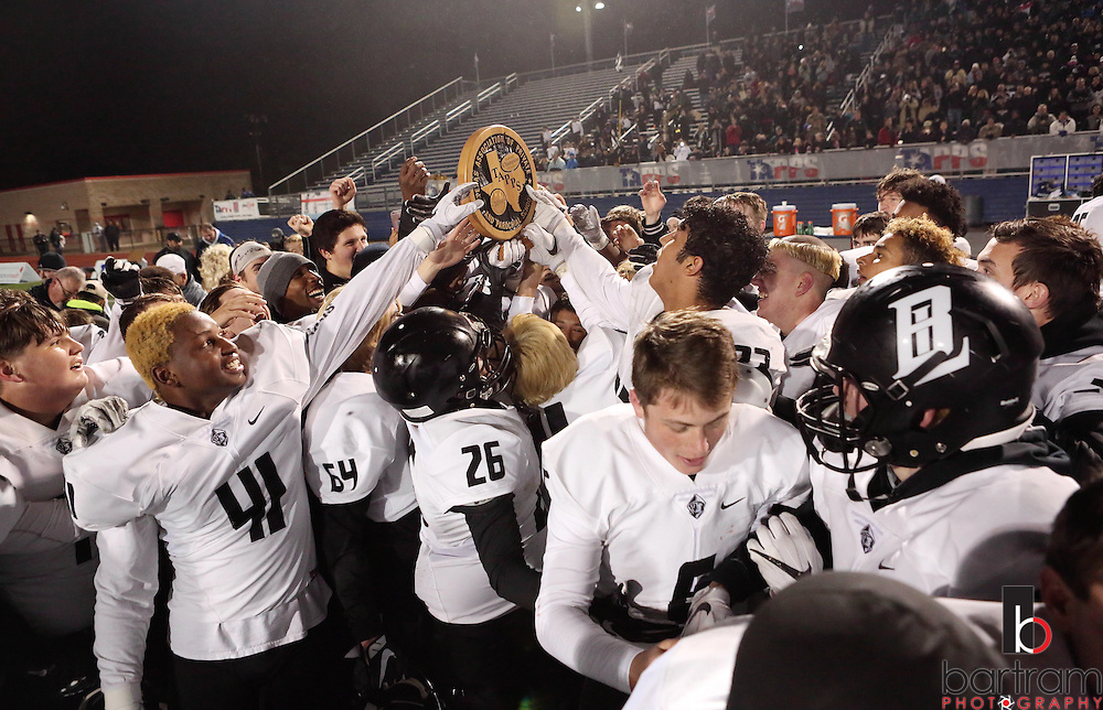 Bishop Lynch players hold the championship trophy following the TAPPS Division I state championship game on Saturday, Dec. 3, 2016 at Panther Stadium in Hewitt, Texas. Bishop Lynch High School won 21-17. (Photo by Kevin Bartram)