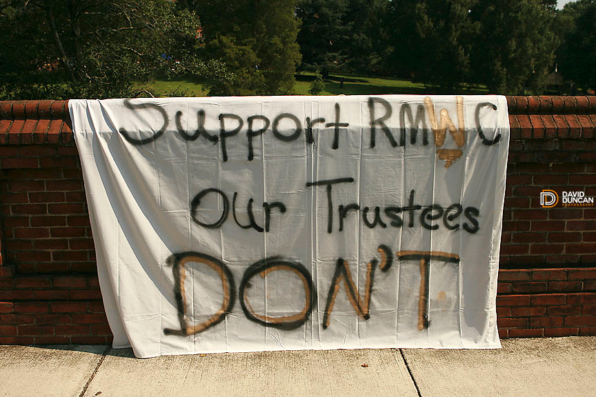 Handmade signs are draped over the 115-year-old wall at Randolph-Macon Woman's College in Lynchburg, VA. Saturday August 9th, 2006 the Board of Trustees voted to allow men to attend the all woman college in 2007. .Photo by David Duncan.