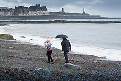 ©Licensed to London News Pictures<br /> 15/06/2019. Aberystwyth, UK.<br /> A couple have the beach to themselves on a grey and wet afternoon at the seaside in Aberystwyth , west Wales, as the dreary and very unseasonal June 'summer' weather continues its hold on the country. Photo credit : Keith Morris/LNP