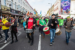 London, UK. 9th February, 2019. Drummers entertain activists from Extinction Rebellion blocking Kingsland Road in Dalston as part of a 'Saturday street party' intended as a means of engagement around climate change and environmental issues with the local community.