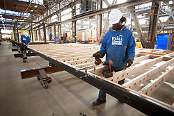 "Blu Homes construction workers assemble state of the art ""green"" LEED certifiable, prefab homes at their Mare Island factory in Vallejo, California. The 250,000 square foot facility was previously used to build submarine periscopes when the US Navy was based there."