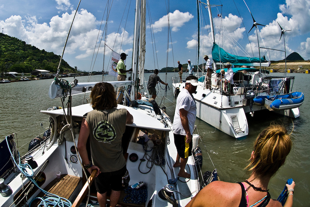 Zac Sunderland gets ready to tie his boat up to Pura Vida before they enter the second set of locks to head through the Panama Canal.