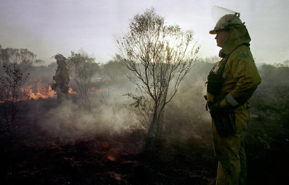 LAKELAND,FL. -John Knowles,right and Jerry Deney, of the Division of Forestry keep watch of a brush fire in Lakeland Wednesday. Division of Forestry set a burn to control the original fire from getting out of hand.(staff/scott iskowitz)
