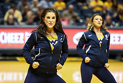 Dec 16, 2017; Morgantown, WV, USA; A West Virginia Mountaineers dance team member performs during a timeout during the first half against the Wheeling Jesuit Cardinals at WVU Coliseum. Mandatory Credit: Ben Queen-USA TODAY Sports