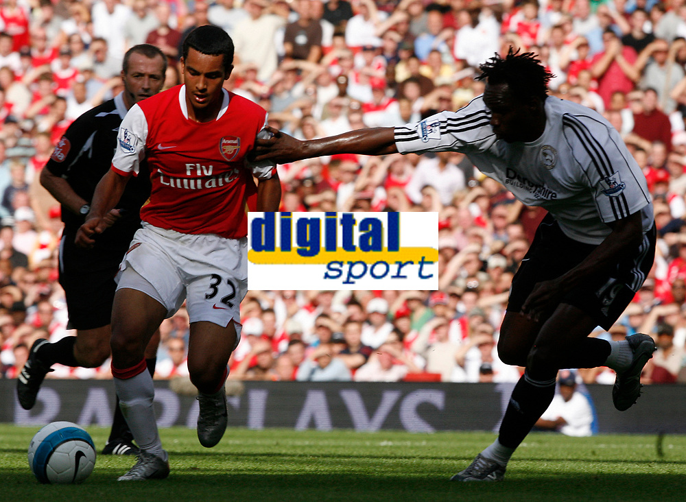 Photo: Steve Bond.<br />Arsenal v Derby County. The FA Barclays Premiership. 22/09/2007. Theo walcott (L) attacks Claude Davis (R)