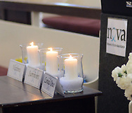 Some candles rest on a table during the annual Candlelight Vigil for crime victims Tuesday April 4, 2017 at Friends Meetinghouse in Newtown, Pennsylvania. NOVA (Network of Victims Assistance) hosted the event in which survivors spoke of their experiences as victims of crime. (Photo by William Thomas Cain)