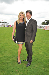 Actress TINA HOBLEY and her husband OLIVER WHEELER at the 25th annual Cartier International Polo held at Guards Polo Club, Great Windsor Park, Berkshire on 26th July 2009.
