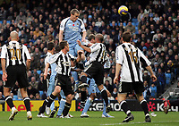 Photo: Paul Thomas.<br /> Manchester City v Newcastle United. The Barclays Premiership. 11/11/2006.<br /> <br /> Man City's Richard Dunne climbs up to head the ball into score, but only to have it disallowed.