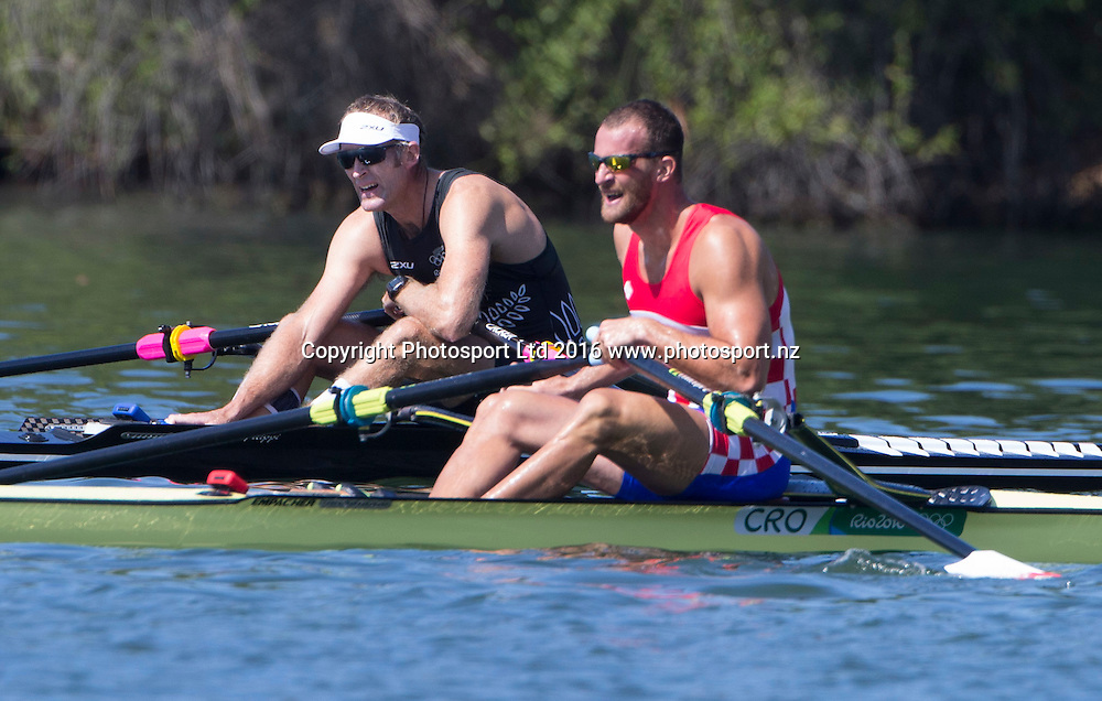 New Zealand's Mahe Drysdale and Croatia's Damir Martin wait for a result after the mens singles at Lagoa Stadium, Olympic rowing.  Rio Olympics Games 2016, Rio de Janeiro. Friday 12 August, 2016. Copyright photo: John Cowpland / www.photosport.nz