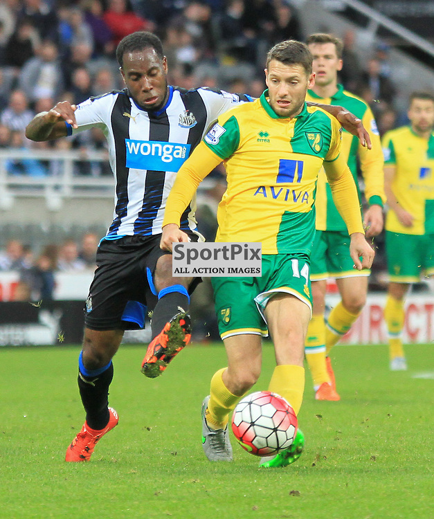 Newcastle United V Norwich City Premier League 18th October 2015; Vurnon Anita (Newcastle, 8) tackles Wes Hoolahan (Norwich, 14)  during the Newcastle V Norwich match, played at St. James Park, Newcastle.